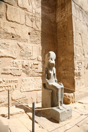 sculpture statue of landmark Egyptian warrior goddess Sekhmet, also Solar deity and protector of pharaohs, monument in Temple of Medinet Habu or Ramses III, in Luxor, Egypt, Africa