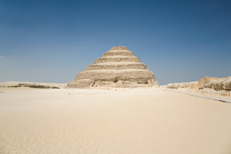 djoser: landscape of Egyptian desert, with archeological area and Saqqara stepped Pyramid of Djoser, from year 2648 Before Christ, next to ancient Memphis city, in Egypt, Africa Stock Photo