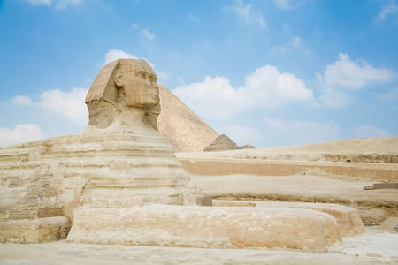 egyptology: landmark of famous Great Sphinx, from century XXVI Before Christ, and behind the Great Pyramid of Khufu, in Giza next to Cairo city Egypt, Africa Stock Photo