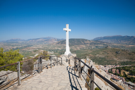 landmark of walkway towards great crucifix in Santa Catalina or St Catherine mountain, public monument and lookout balcony over Jaen city, Andalusia, Spain Europe Stock Photo