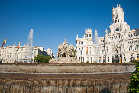 landmark of famous neoclassical sculpture monument fountain of greek goddess Cibeles in Madrid city Spain Europe, facade of public town hall building. Made in year 1782 by Ventura Rodriguez artist