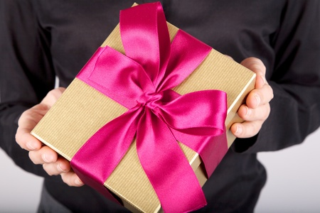 woman detail with a gift box in her hands photo