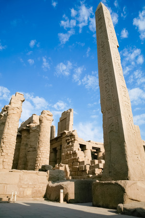 big obelisk of Queen Hatshetsut with carving figures and hieroglyphs in landmark Egyptian Karnak Temple, public monument declared a World Heritage by Unesco, in Luxor, Egypt, Africa