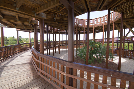 rise circular ramp of wooden lookout tower, with columns and interior garden, in public park named Felipe VI or Forest Park Valdebebas, in Madrid city, Spain