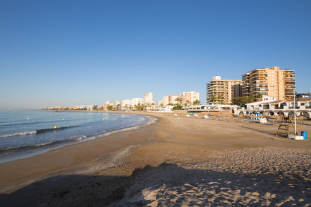 heliopolis: landscape sandy Heliopolis Beach, in Benicassim, Castellon, Valencia, Spain, Europe. Buildings, blue clear sky and Mediterranean Sea