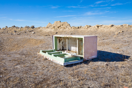 abandoned open old refrigerator in the desert countryside, in Spain, Europe Stock Photo