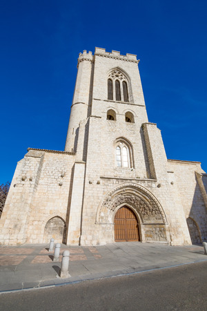 facade of ancient building church of San Miguel, or Saint Michael, romanesque and gothic monument from eleventh century, in Palencia city, Castile Leon, Spain, Europe Stock Photo