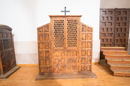 wooden confessional indoor church parish of Our Lady of the Mantle, in Riaza, Segovia, Castile, Spain, Europe Imagens