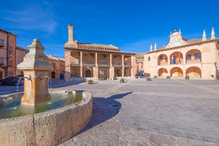 main square with fountain, church of San MIguel (Saint Michael), from twelfth century, and town hall public building, from sixteenth century, in old town of Ayllon village, Segovia, Spain, Europe