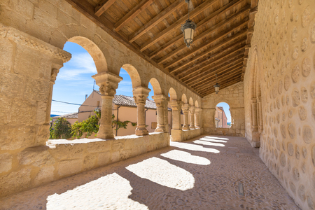 portico gallery in church San Miguel (Saint Michael), romanesque style landmark and public monument from eleventh century, in San Esteban de Gormaz, Soria, Spain, Europe Stock Photo