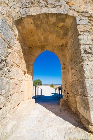 open door framed in stone and access footbridge of castle in Penaranda de Duero village, landmark and public monument from eleventh century, in Burgos, Castile and Leon, Spain, Europe Stock Photo