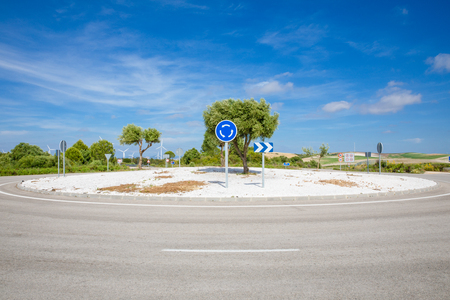 blue roundabout traffic signal in lonely rural road in of Spain, Europe
