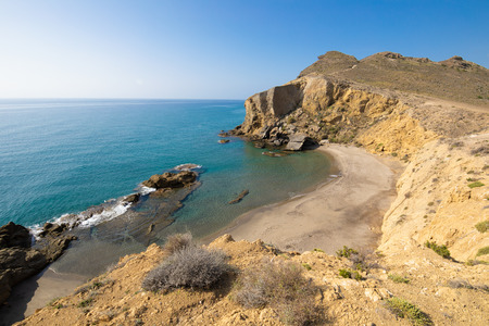 Yellow or Amarillos Beach, famous wild and beautiful seaside, from top of the cliff, in Gata Cape Natural Park, Almeria (Nijar, Andalusia, Spain, Europe)