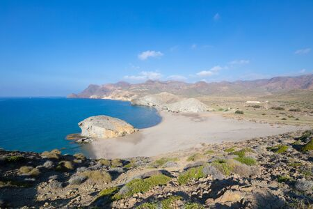 lonely Monsul Beach from top of the mountain, in Gata Cape Natural Park (Cabo de Gata in Spanish), wild and beautiful famous destination, in Almeria (Nijar, Andalusia, Spain, Europe)