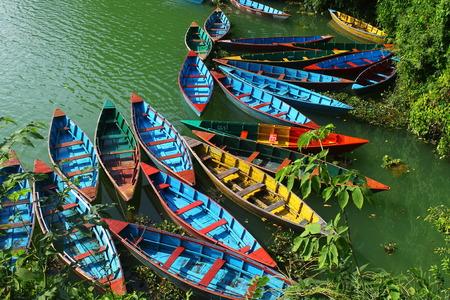 pokhara: Wooden canoes on Pokhara Lake in Nepal