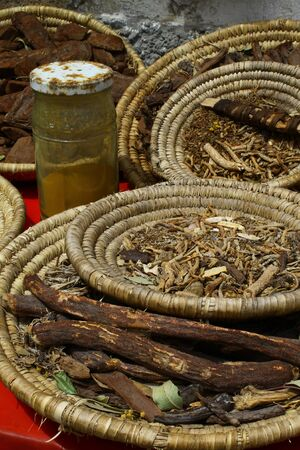 speculate: We can only speculate about the contents and uses of the roots and spices on display in wicker baskets in Essaouira, Morocco.