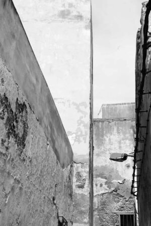 diagonals: A black and white study of diagonals in an alleyway in Essaouira, Morocco, leads the eye into this interesting composition. Stock Photo