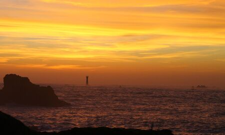 guernsey: The Hanois lighthouse in Guernsey at sunset.