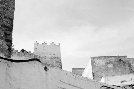 ramparts: This black and white composition places the diagonal of the nearer wall against the ramparts of the tower behind.