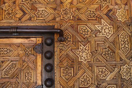 ironwork: The ironwork on this Moorish door serves to contract against the skilful detail of the wooden decoration.