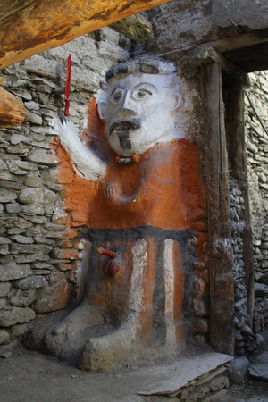 idols: Passers-by in the village of Kagbeni in Nepal may come across this dramatic figure which complete with his blood-red sword appears to be guarding an entrance.