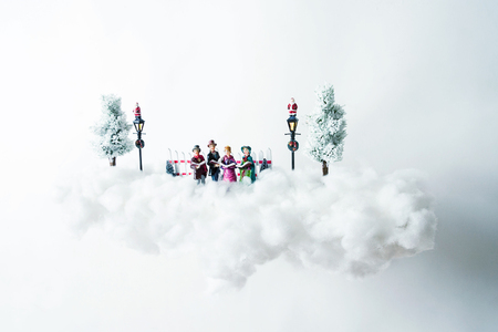 cotton cloud: Christmas carolers floating on a cloud of cotton