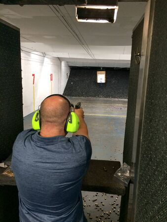 Fireams training handgun at indoor range vertical Foto de archivo