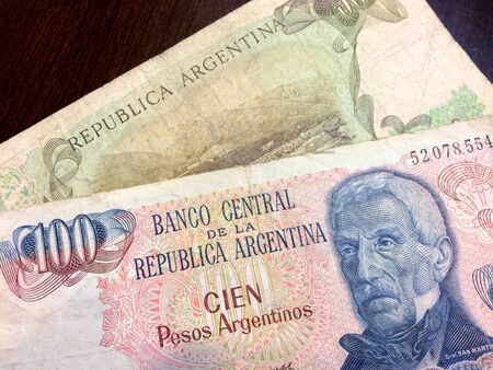 Foreign money cash bills on table argentina Imagens