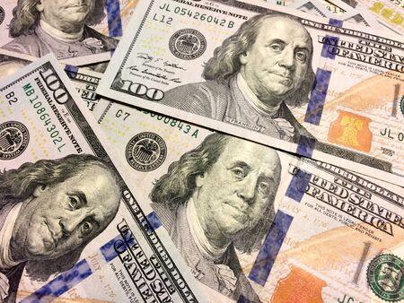 pile of American cash money one hundred dollar bills Stock Photo