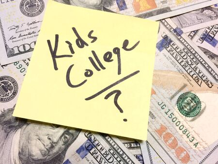 American cash money and yellow post it note with text Kids College with question mark in black color aerial view Imagens