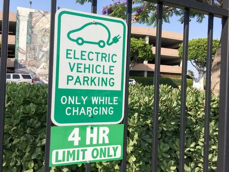 Electric vehicle charging parking space sign in green