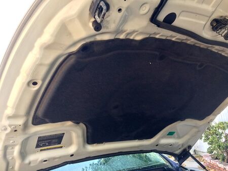 Cleaned car engine compartment hood raised up