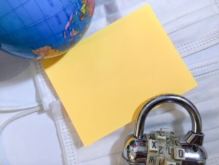 Earth global worldwide lock down with text space on white globe combination padlock background