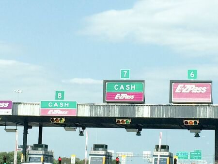 Highway toll booth stop on freeway in day time