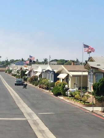Trailer park mobile homes america flag with clean street sunny day