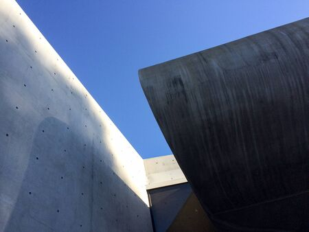 Modern concrete architecture abstract background with blue sky up high
