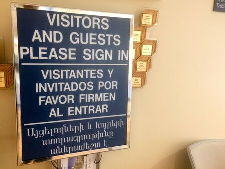 visitor check in registration sign at hospital reception lobby security