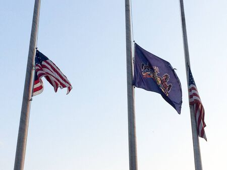 Fags at half staff in america mourning respect