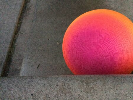 Modern art rainbow sphere geometric shapes in space on gray concrete