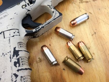 Unique Glock handgun firearm pistol with bullets from US Marine Stock fotó