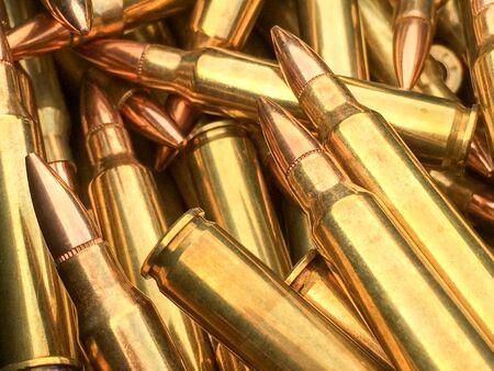Bullets .223 brass 5.56 caliber ammo for AR 15 rifle ammo Фото со стока