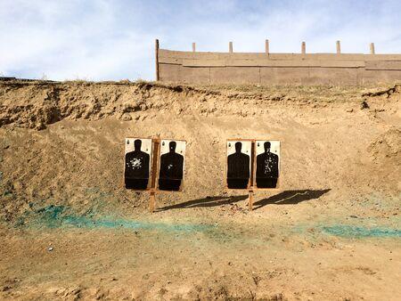Shooting targets at gun range outdoor black silhouettes