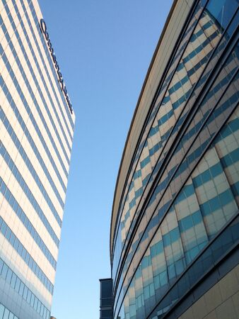 Modern office building on blue sky looking way up high tower