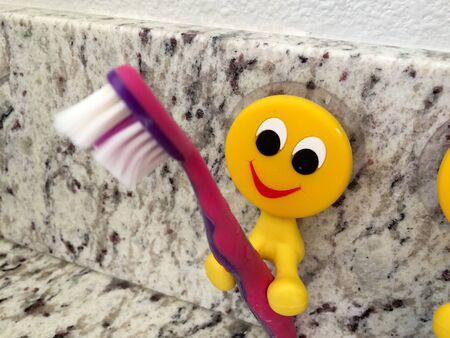Fun yellow emoji smiling dental products toothbrush holders for kids