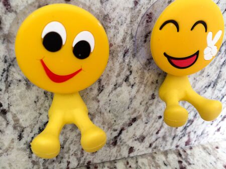 Happy fun yellow smiling emoji couple with peace sign dental toys Banco de Imagens