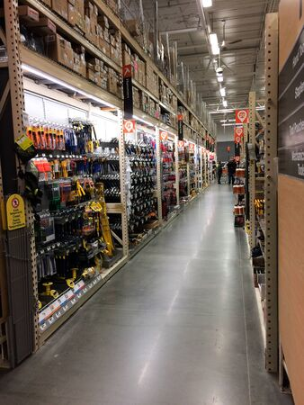 Aisle view at home improvement warehouse store with people