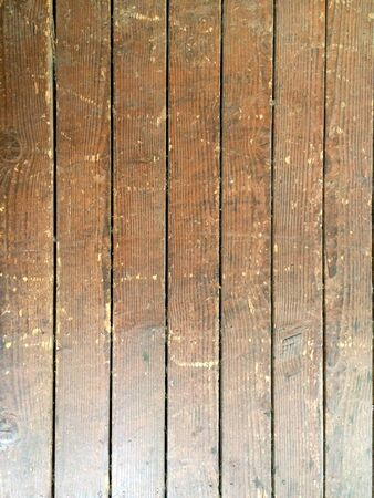 wood plank floor brown and scuffed by shoes and boots design background