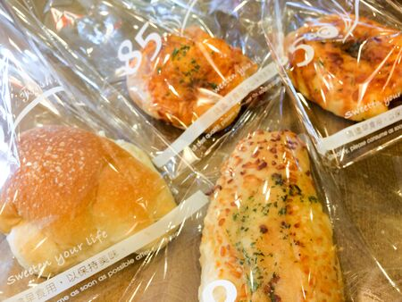 Fresh baked soft bread at famous bakery in cellophane plastic bags