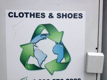 clothes and shoes donation recycle bin symbol reuse reduce recycle