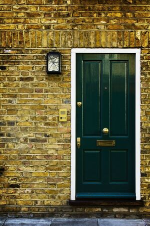 stereotypically: Typical British door with doorbell in West London.